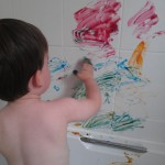 Containing the mess – finger painting in the bath – 15 months