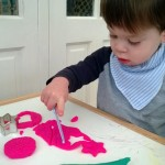 Play doh playtime and threading cheerios on spaghetti – 18 months old