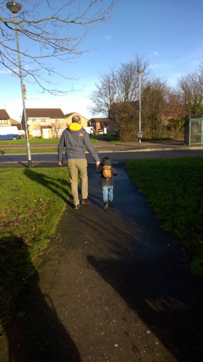 running to playgroup with daddy on his first day